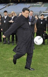China's President Xi Jinping kicking a football in his Mexico tour