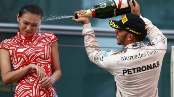 Lewis Hamilton's win at the Chinese Grand Prix has been marred by his controversial action of spraying champagne in the face of a hostess (Getty Images).